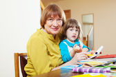 Mature woman and baby girl drawing with pencils — Stock Photo