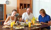 Lovely happy multigeneration family having healthy dinner — Stock Photo