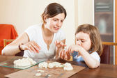Happy mother and baby sculpting from plasticine or dough in home — Stock Photo