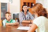 Son and father answer questions of a social worker — Stock Photo