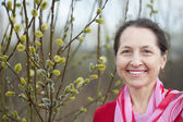 Happy woman against spring willow branches — Stock Photo