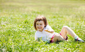 Three year old child playing at grass — Stock Photo