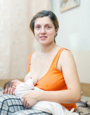 Baby breast feeding at home — Stock Photo