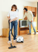Woman and man doing housework together — Stok fotoğraf