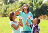 Parents with teenager drinking water — Stock Photo