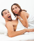 Middle-aged couple caught in bed — Stock Photo
