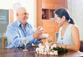 Happy senior man giving woman the jewel — Stock Photo