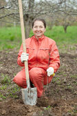Woman resetting bush sprouts — Stock Photo