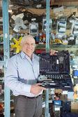Man holds automotive correction tool set — Stock Photo