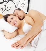 Loving middle-aged couple awaking together — Stock Photo