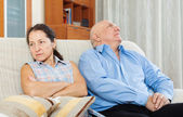 Family quarrel. Mature woman having conflict with man — Stock Photo