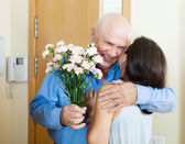 Loving mature couple at home — Stock Photo
