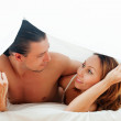 Stock Photo: Couple together under sheet