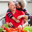 Loving mature couple cooking together — Stock Photo