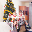 Family with Christmas tree — Stock Photo