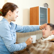 Woman caring for sick man — Stock Photo