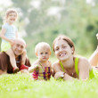 Happy family of four in summer park — Stock Photo