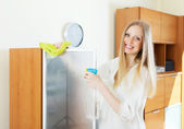 Positive housewife cleaning glass — Stock Photo