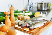 Fresh trout in kitchen — Stock Photo
