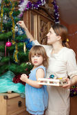 Woman and her daughter preparing for Christmas — Stock Photo