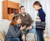 Mother and father scolding teenager — Stock Photo