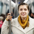 Girl passanger standing in metro — Stock Photo