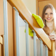 Stock Photo: Womdusting railings at home