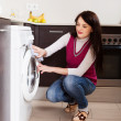 Woman cleaning washing machine — Stock Photo