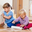 Two children playing with electricity — Stock Photo