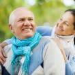 Happy senior man and smiling mature woman — Stock Photo