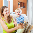 Mom and child on sofa — Stock Photo #40791049