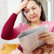 Mature woman having grief after readed news — Stock Photo