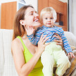 Portrait of happy woman with toddler — Stock Photo #40791123