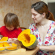 Mother with daughter cooking pumpkin — Stock Photo #40791479