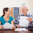 Mature couple holding financial documents — Stock Photo