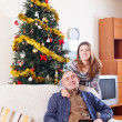 Happy couple celebrating Christmas — Стоковое фото