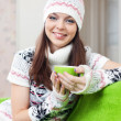 Stock Photo: Girl warms with cup of tea