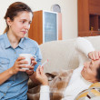 Stock Photo: Adult daughter caring for sick mother