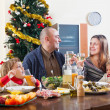 Happy family near Christmas tree — Stock fotografie