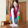 Long-haired girl dusting table — Stock Photo #40791803