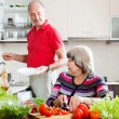 Elderly man and mature woman doing housework — Stock Photo #40792249