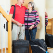 Positive mature couple going on vacation — Stock Photo #40792405