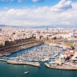 Aerial view of Barcelona city with Port Vell — Stock Photo #40792565