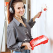Happy woman makes repairs in the apartment — Stock Photo #40792749