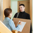 Postman brought package — Stock Photo