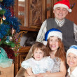 Happy family in santa hats — Stock Photo