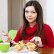 Woman divided lunch for two parts — Stock Photo #40792817
