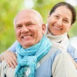 Portrait of mature couple at autumn park — Foto de stock #40792879
