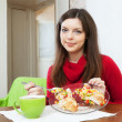 Woman divided lunch for two parts — Stock Photo #40793017