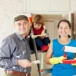 Parents with child repairs at home — Stock Photo